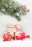 Christmas gift boxes and xmas fir tree. Branch Royalty Free Stock Images