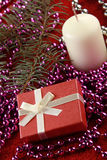 Christmas gift and candle Stock Photos