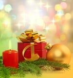 Christmas gift and candle Stock Photos