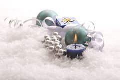 Christmas gift, candle and ornaments Stock Photos