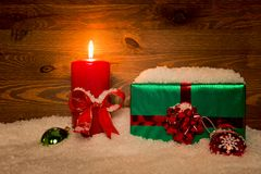 Christmas gift and candle Royalty Free Stock Image