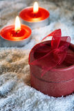 Christmas gift and candles Royalty Free Stock Photo