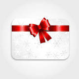 Christmas gift card. With a red ribbon Royalty Free Stock Image