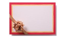 Christmas gift card gold bow red border isolated white stock photo