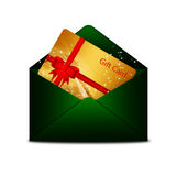 Christmas gift card in green envelope  over white Stock Photography