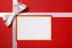 Christmas gift card or label and envelope, white ribbon bow, red Stock Photos