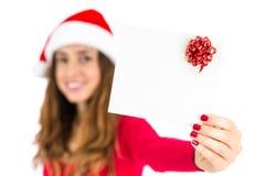 Christmas gift card presented by santa woman Royalty Free Stock Photo