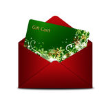 Christmas gift card in red envelope  over white Royalty Free Stock Photo