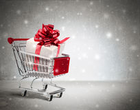 Christmas gift in cart Stock Image