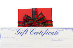 Christmas Gift Certificate. Christmas gift with a gift certificate isolated on white stock photo