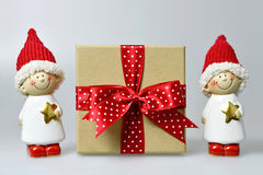 Christmas gift and Christmas elves. On light background stock images