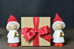 Christmas gift and Christmas elves. Christmas gift and little Christmas elves stock images
