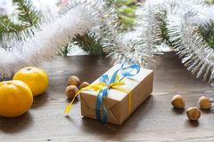 Christmas gift Christmas New Year with decoration of ukrainian national colors midst fruits and tinsel Stock Image