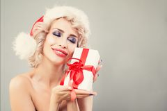 Christmas Gift Concept. Christmas Woman in Santa Hat Stock Image