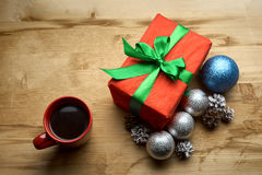 Christmas gift with a cup of coffee on the table Stock Images