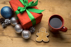 Christmas gift with a cup of coffee on the table Royalty Free Stock Image