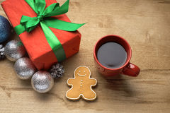 Christmas gift with a cup of coffee on the table Royalty Free Stock Photos