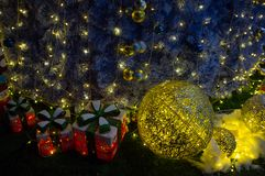 Christmas gift in December. Some Christmas gifts are piled by the Christmas tree in winter Stock Photography