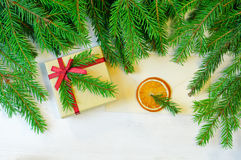 Christmas gift decorated with Christmas tree twig and envelope Stock Photos