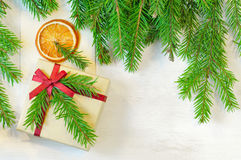 Christmas gift decorated with Christmas tree twig and  envelope Stock Image
