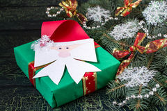Christmas gift decorated with a handmade bow in the form Santa C Stock Photo