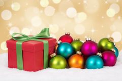 Christmas gift decoration with colorful balls and golden backgro Stock Photo