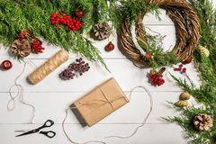 Christmas gift decoration with handmade DIY on a white wooden background. Do it by yourself. Stock Photography