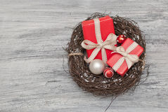 Christmas. Gift and decoration in the nest Stock Image