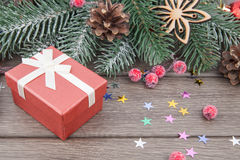 Christmas gift and decoration in red. Color on wooden background Royalty Free Stock Image