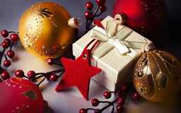 Christmas gift and decorations. With red star and Christmas-tree balls Royalty Free Stock Photography