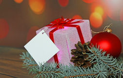 Christmas gift with decorations. On abstract background Stock Images