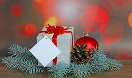 Christmas gift with decorations. On abstract background Royalty Free Stock Photo
