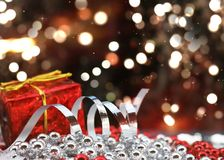 Christmas gift and decorations on defocussed bokeh lights backgr. Ound with stars Royalty Free Stock Photography
