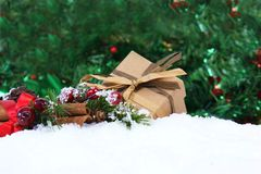 Christmas gift and decorations nestled in snow. With bokeh lights background Stock Photography