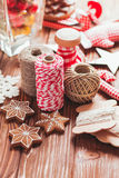 Christmas gift decorations. Red and rustic ropes and gingerbread Royalty Free Stock Images
