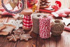 Christmas gift decorations. Red and rustic ropes and gingerbread Stock Photos