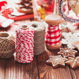 Christmas gift decorations. Red and rustic ropes and gingerbread Stock Photography