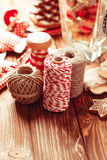 Christmas gift decorations. Red and rustic ropes and gingerbread Stock Photo
