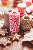 Christmas gift decorations. Red and rustic ropes and gingerbread Royalty Free Stock Photography
