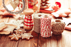 Christmas gift decorations. Red and rustic ropes and gingerbread Stock Images