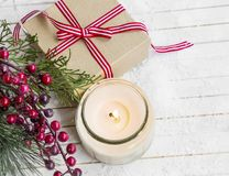 Christmas gift with decorations and scented candle , festive set. Ting Royalty Free Stock Images