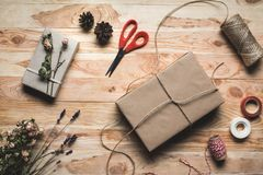 Christmas gift and decorations. Top view of christmas gift wrapped in kraft paper and decorations Royalty Free Stock Photos