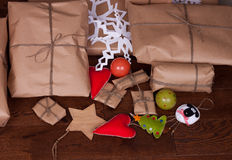 Christmas gift and decorations for tree on wooden Stock Photography