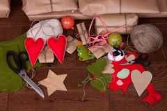 Christmas gift and decorations for tree on wooden Royalty Free Stock Photo