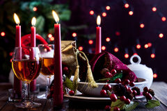 Christmas gift in dishware at the table Royalty Free Stock Images
