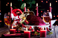Christmas gift in dishware at the table Royalty Free Stock Photo