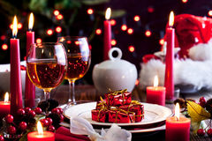 Christmas gift in dishware at the table Stock Photo
