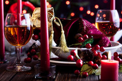 Christmas gift in dishware at the table Stock Image