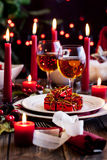 Christmas gift in dishware at the table Stock Photos