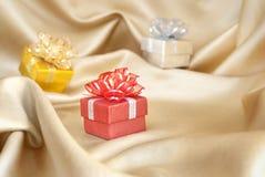 Christmas gift, drape. Christmas gift, on golden drape Stock Images